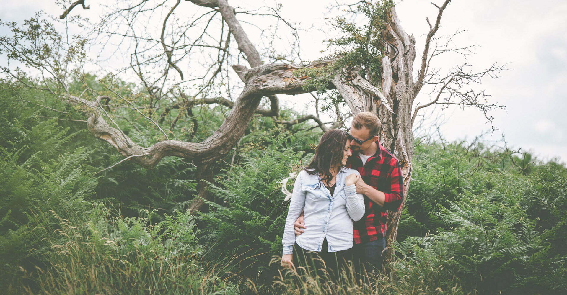 old fallen tree pre wedding engagement Levisham Wedding Photographer Yorkshire Wedding Photography North Yorkshire by Chris and Hazel Wedding Photography Ross Patterson Laurelin Matulis
