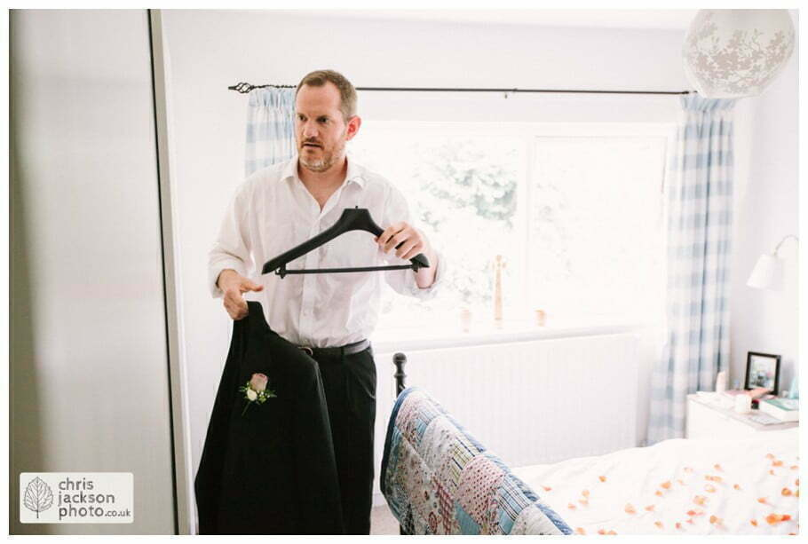 groom prep preparations getting ready suit putting on documentary york wedding photographer chris and hazel wedding photography