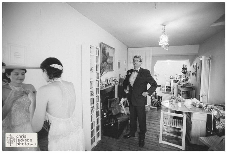 bride preparations getting ready bride in wedding dress father of bride proud watching documentary york wedding photographer chris and hazel wedding photography