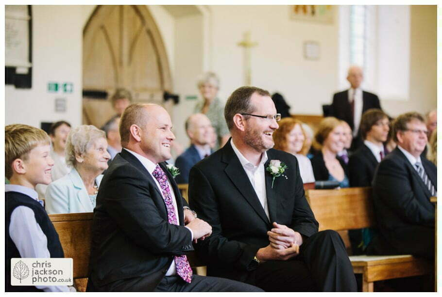 groom sat waiting for bride in church nervous laughter york heslington church wedding day weddings documentary york wedding photographer chris and hazel wedding photography