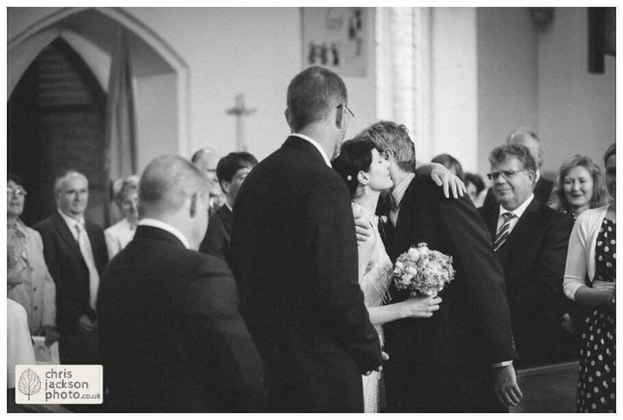 bride kissing kisses kiss father groom york heslington church wedding day weddings documentary york wedding photographer chris and hazel wedding photography
