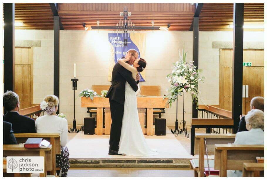bride groom wedding ceremony alter first kiss york heslington church wedding day weddings documentary york wedding photographer chris and hazel wedding photography