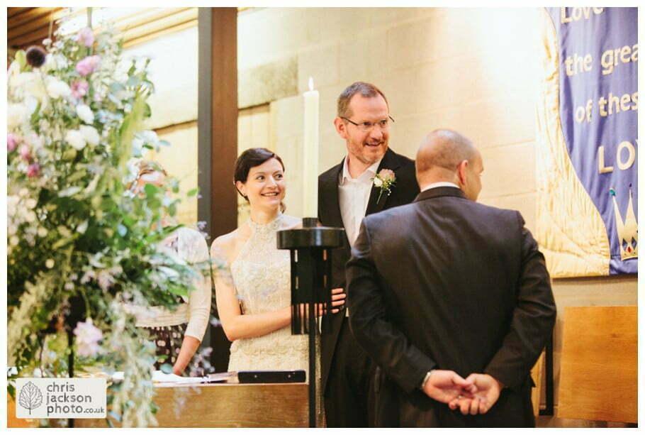 bride groom wedding ceremony alter signing register york heslington church wedding day weddings documentary york wedding photographer chris and hazel wedding photography