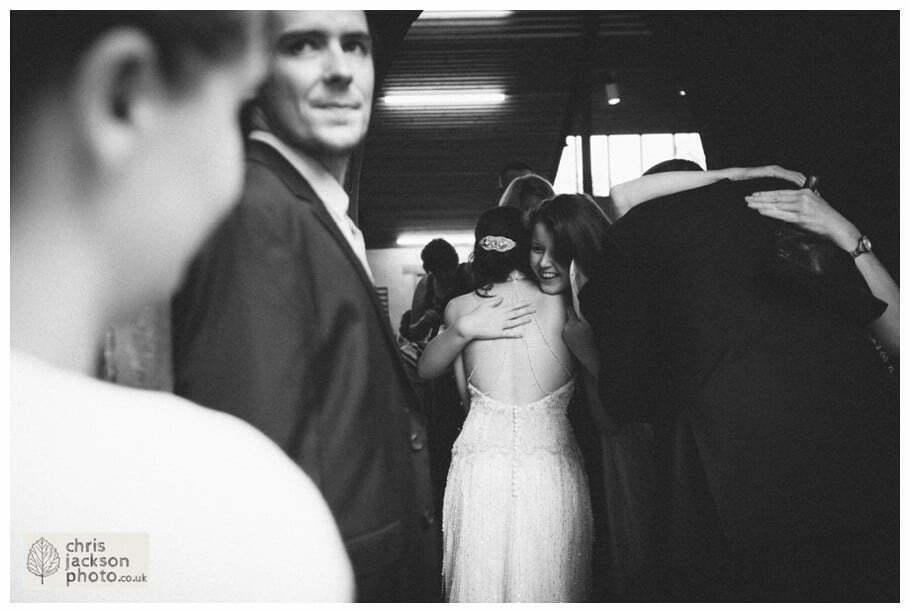 bride groom wedding church guests family congratulating york heslington church wedding day weddings documentary york wedding photographer chris and hazel wedding photography
