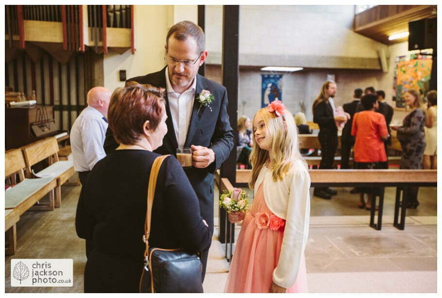groom with daughter after wedding in church york heslington church wedding day weddings documentary york wedding photographer chris and hazel wedding photography