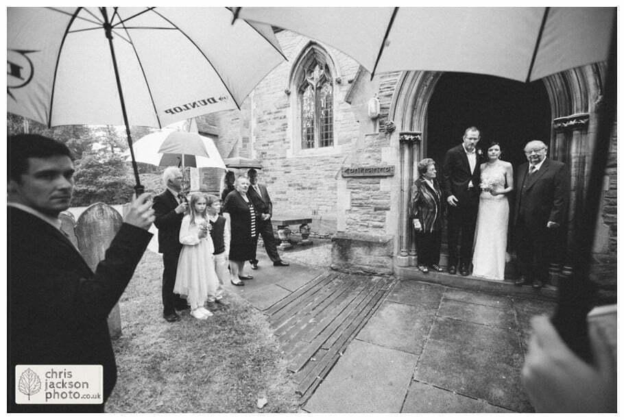 bride groom wedding rain raining rainy wedding day umbrella umbrellas york heslington church wedding day weddings documentary york wedding photographer chris and hazel wedding photography