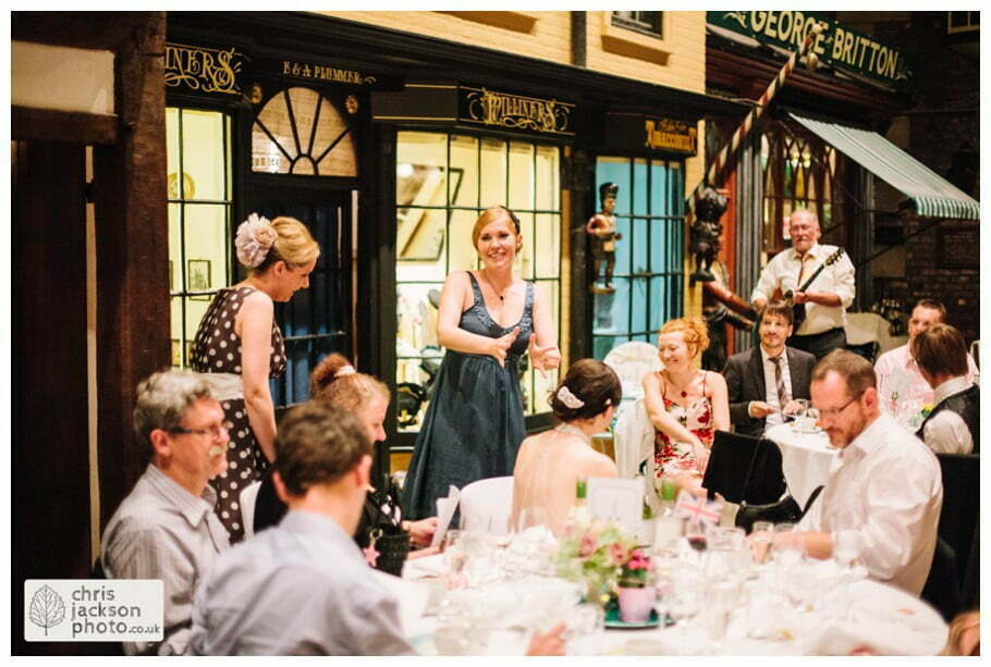 family singing wedding breakfast old victorian street set wedding venue york castle museum wedding photography wedding photographer York chris & hazel wedding photography