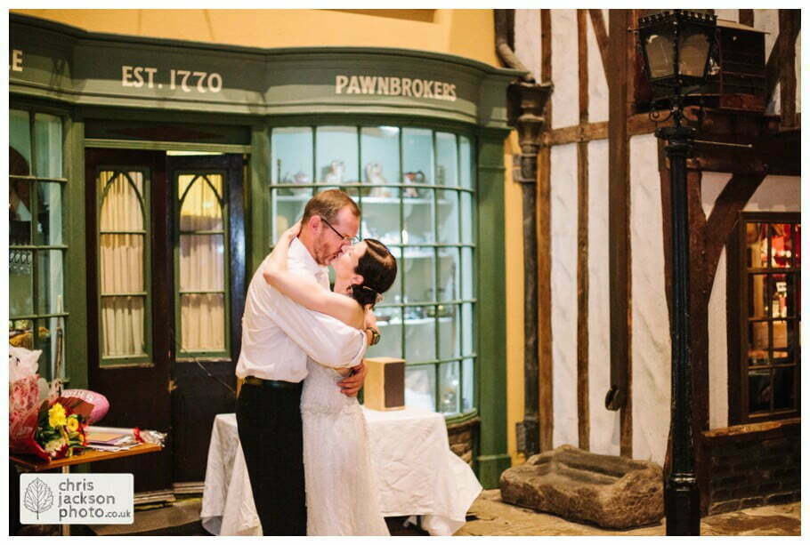 bride and groom first dance kiss kissing old victorian street set wedding venue york castle museum wedding photography wedding photographer York chris & hazel wedding photography