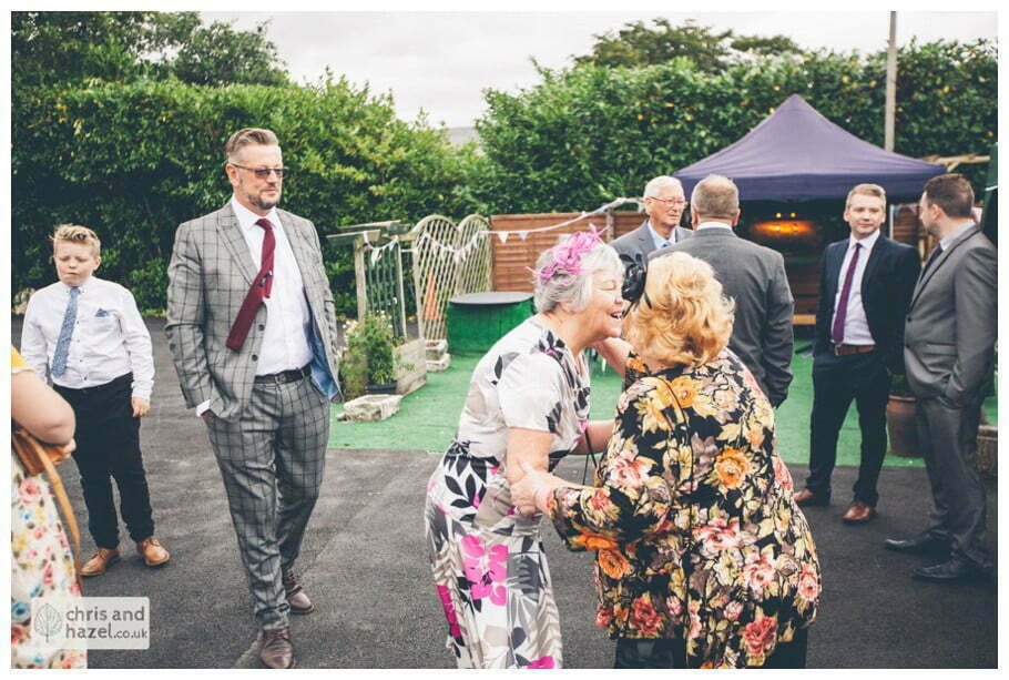 guests outside The venue at Wimberry hill wedding day diy vintage wedding glossop The venue at wimberry hill glossop wedding photography by Glossop wedding photographers chris and hazel natasha thorley jake rowarth
