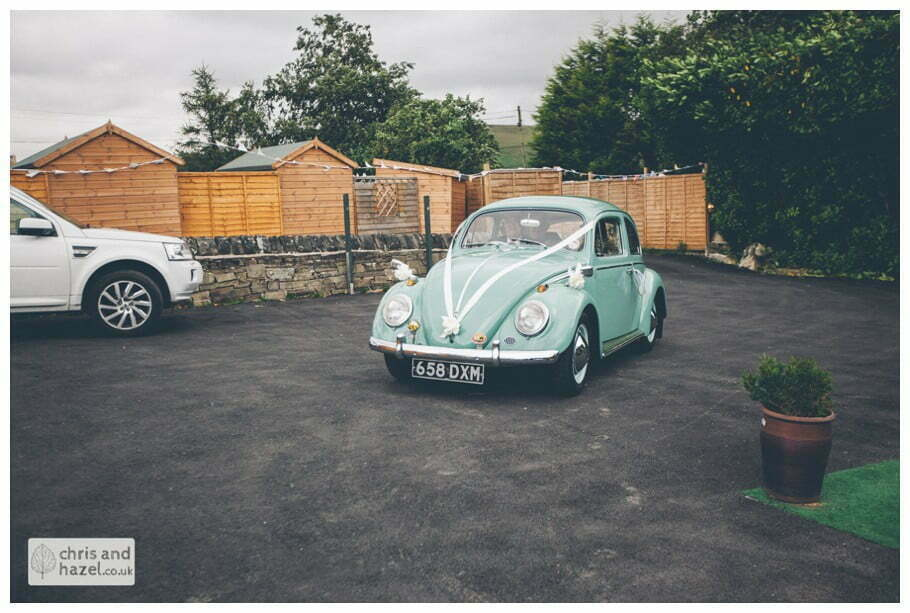 bride arriving in jade green volkswagen beetle outside The venue at Wimberry hill wedding day diy vintage wedding glossop The venue at wimberry hill glossop wedding photography by Glossop wedding photographers chris and hazel natasha thorley jake rowarth