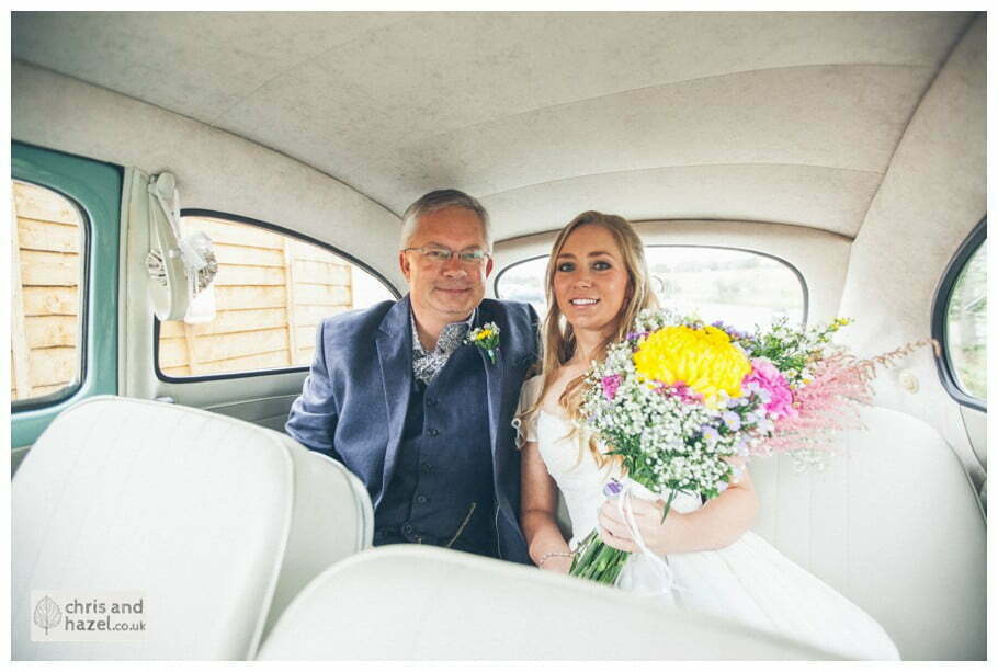 bride and father of bride in wedding car arrive volkswagen beetle outside The venue at Wimberry hill wedding day diy vintage wedding glossop The venue at wimberry hill glossop wedding photography by Glossop wedding photographers chris and hazel natasha thorley jake rowarth
