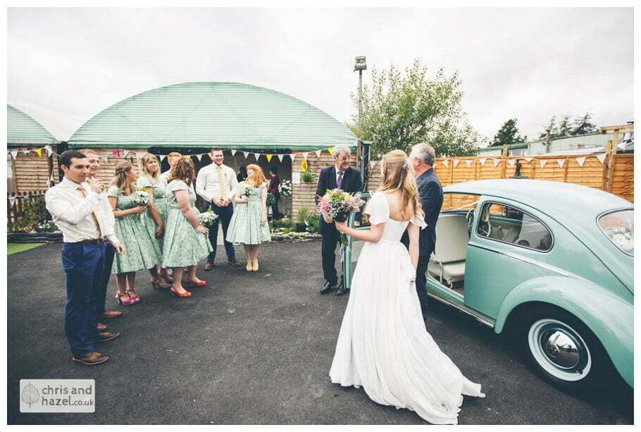 bride and father of bride with ushers and bridesmaids wedding car volkswagen beetle outside The venue at Wimberry hill wedding day diy vintage wedding glossop The venue at wimberry hill glossop wedding photography by Glossop wedding photographers chris and hazel natasha thorley jake rowarth