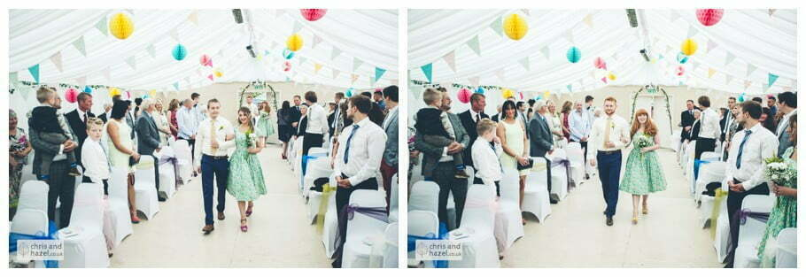 bridesmaids and ushers walk down aisle inside The venue at Wimberry hill wedding day diy vintage wedding glossop The venue at wimberry hill glossop wedding photography by Glossop wedding photographers chris and hazel natasha thorley jake rowarth