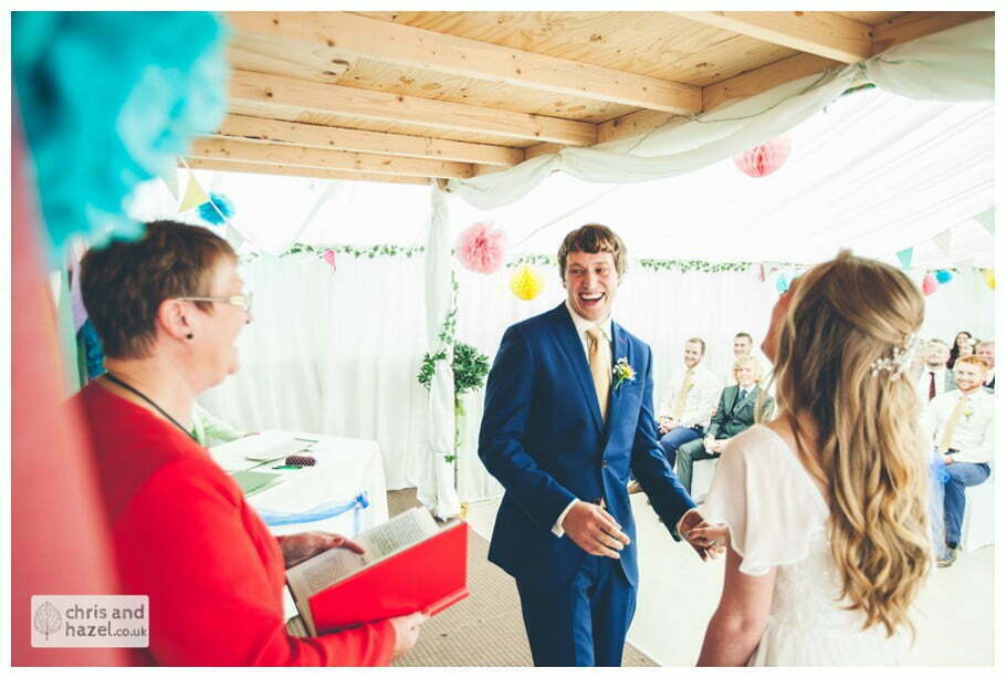 bride and groom at altar ring exchange inside The venue at Wimberry hill wedding day diy vintage wedding glossop The venue at wimberry hill glossop wedding photography by Glossop wedding photographers chris and hazel natasha thorley jake rowarth