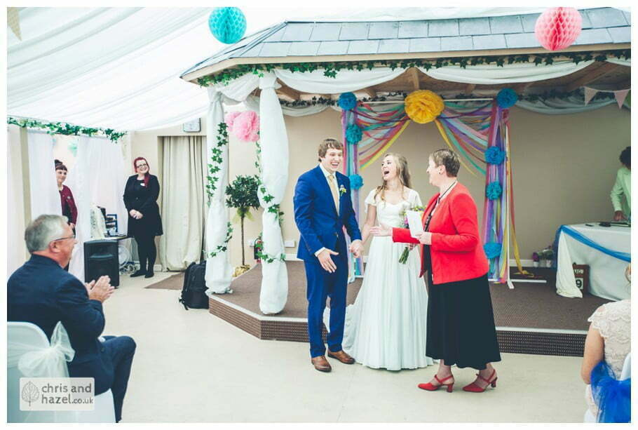 bride and groom presented with marriage certificate inside The venue at Wimberry hill wedding day diy vintage wedding glossop The venue at wimberry hill glossop wedding photography by Glossop wedding photographers chris and hazel natasha thorley jake rowarth