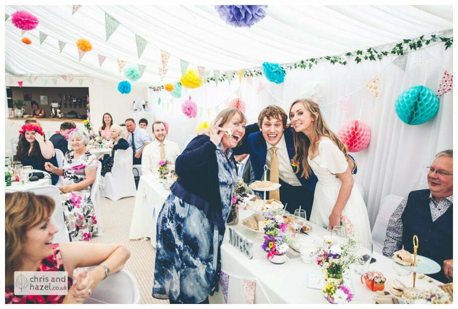 bride and groom judge baking competition great british bake off winners apron inside The venue at Wimberry hill wedding day diy vintage wedding glossop The venue at wimberry hill glossop wedding photography by Glossop wedding photographers chris and hazel natasha thorley jake rowarth