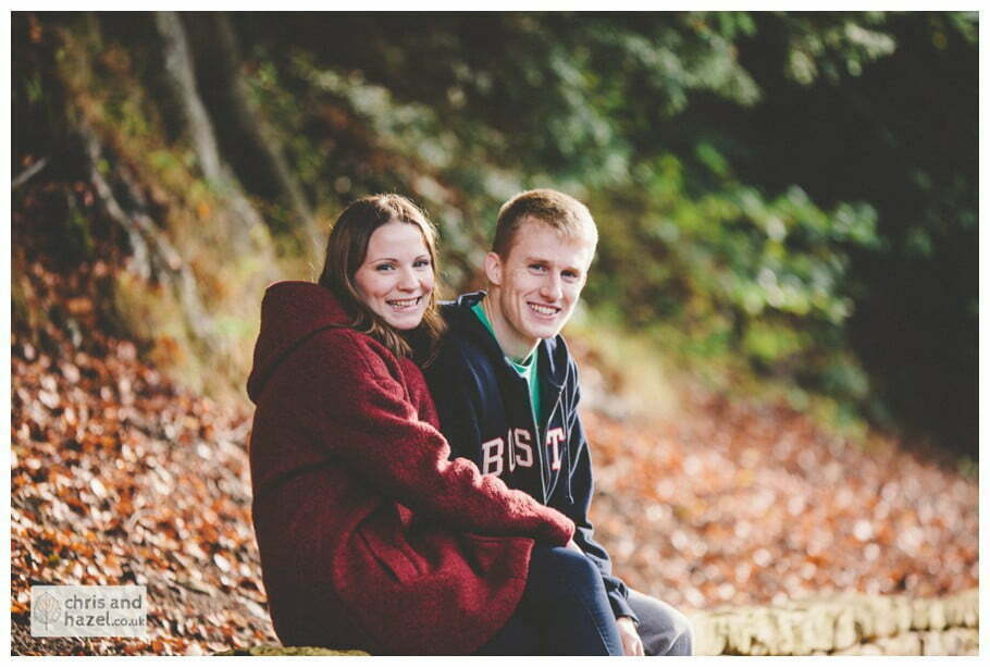 Rippon engagement photography wedding photographer Fountains Abbey yorkshire wedding photographer chris and hazel ruins couple saw on wall autumn orange leaves ben charig frankie drummond
