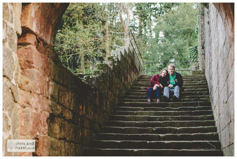 Rippon engagement photography wedding photographer Fountains Abbey yorkshire wedding photographer chris and hazel ruins couple sat on steps inside ruins ben charig frankie drummond