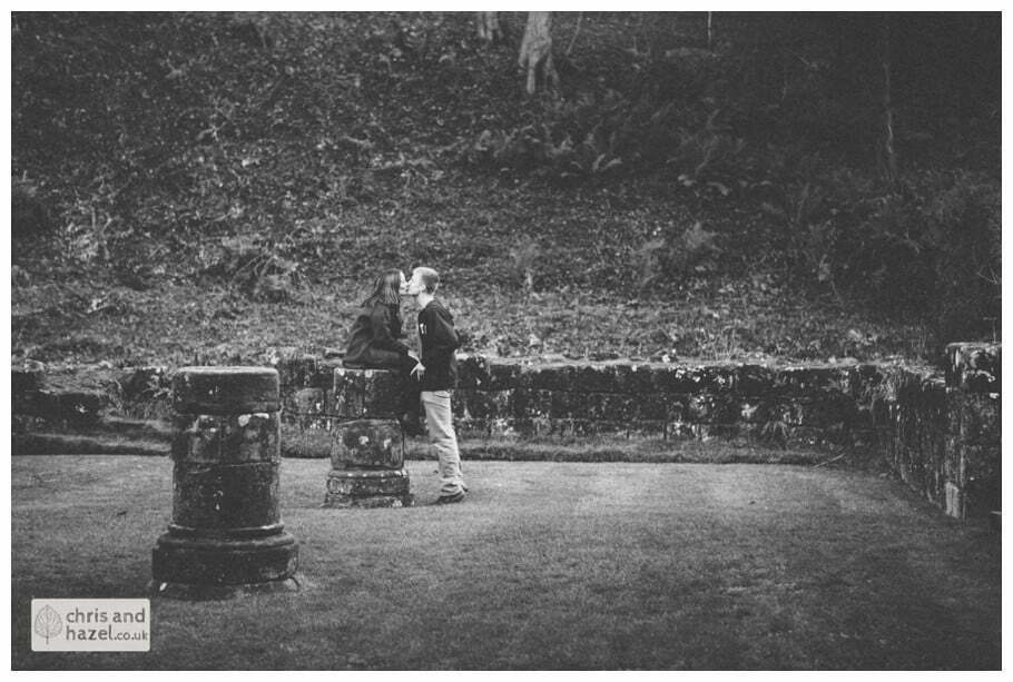 Rippon engagement photography wedding photographer Fountains Abbey yorkshire wedding photographer chris and hazel ruins couple sat on ruins ben charig frankie drummond