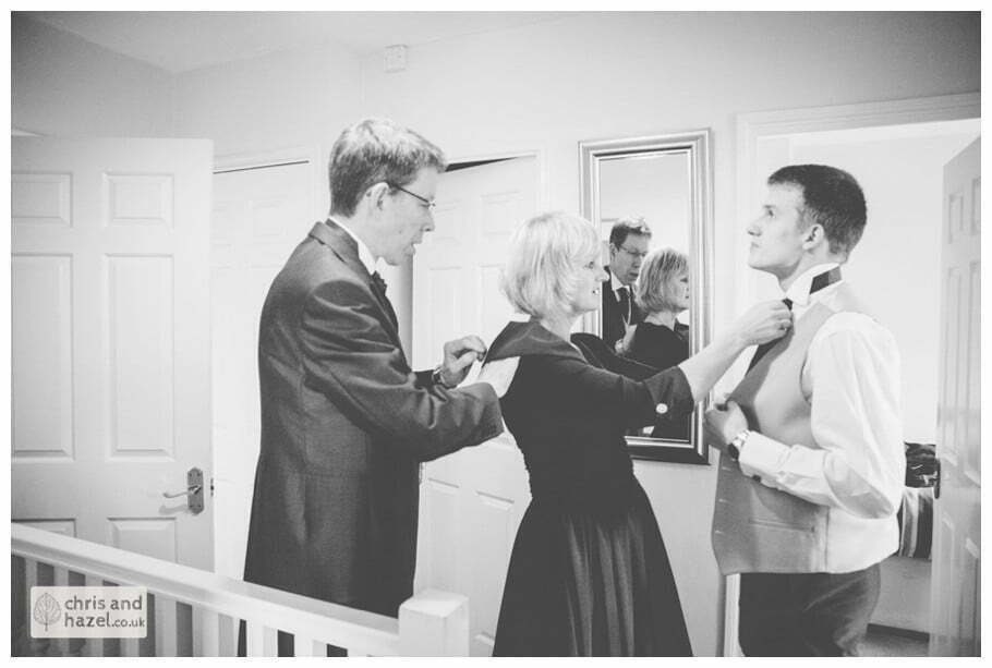 groom with father and mother getting ready preparations york city centre documentary wedding photography ben charig frankie drummond wedding photographer york wedding photography wedding winter chris and hazel wedding photography york