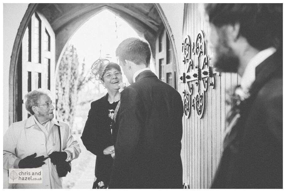 groom and ushers with guests inside heslington church documentary wedding photography ben charig frankie drummond wedding photographer heslington church wedding york wedding photography wedding winter chris and hazel wedding photography york