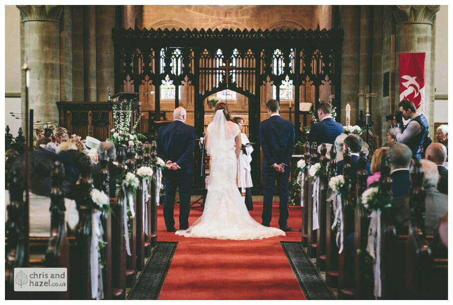 bride and groom at front of church altar ceremony Whitly Church wedding Dewsbury Wedding Photographer Whitly Chris and Hazel Wedding Photography Steven Mountford Rachel Moore