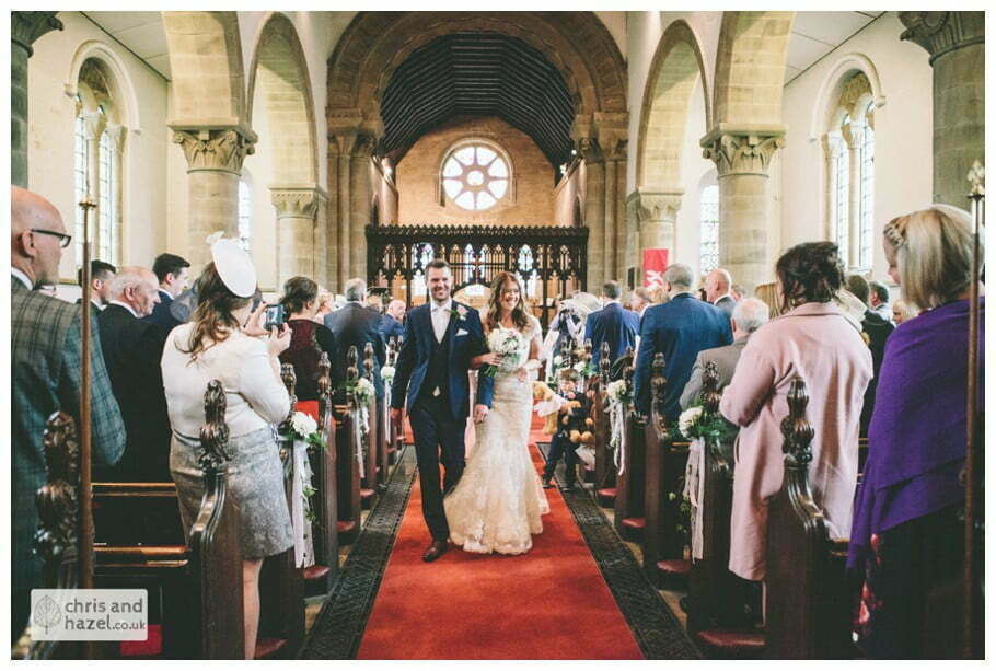 bride and groom walking down aisle ceremony Whitly Church wedding Dewsbury Wedding Photographer Whitly Chris and Hazel Wedding Photography Steven Mountford Rachel Moore