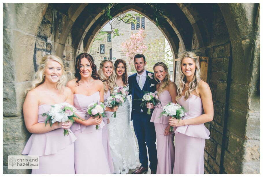 bride and groom with bridesmaids outside Whitly Church wedding Dewsbury Wedding Photographer Whitly Chris and Hazel Wedding Photography Steven Mountford Rachel Moore