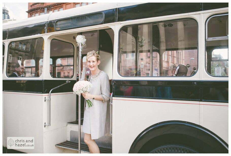 Bride vintage wedding bus single decker Leeds town hall wedding photography leeds town hall steps robin young clare robertson wedding