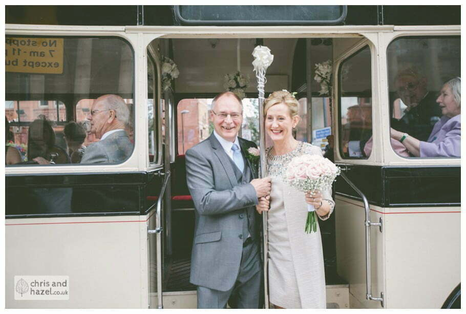 Single decker vintage wedding bus bride groom Leeds town hall wedding photography leeds town hall steps robin young clare robertson wedding