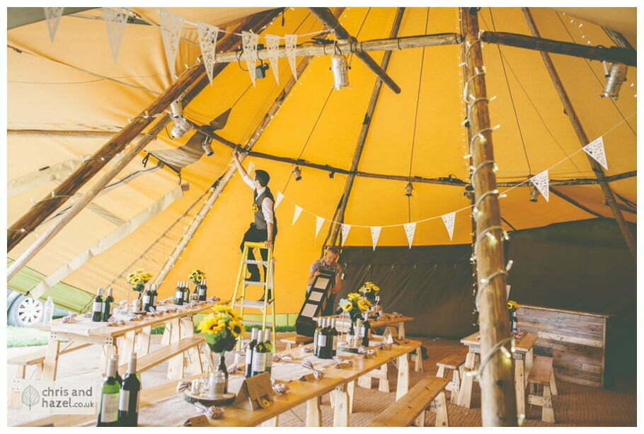 groom decorating rustic wedding theme hessian papkata tipi teepee documentary Wedding Photographer Harrogate Wedding Photography Braisty Estate by Chris and Hazel Wedding Photography Jonny Dunn Stef Brown