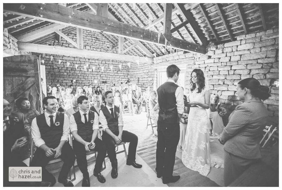bride and groom at altar humanist wedding ceremony in barn documentary Wedding Photographer Harrogate Wedding Photography Braisty Estate by Chris and Hazel Wedding Photography Jonny Dunn Stef Brown