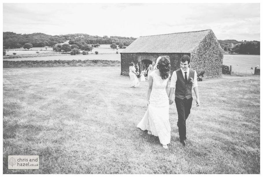 bride and groom walking up hill to papkata tipi teepee rustic wedding theme hessian documentary Wedding Photographer Harrogate Wedding Photography Braisty Estate by Chris and Hazel Wedding Photography Jonny Dunn Stef Brown