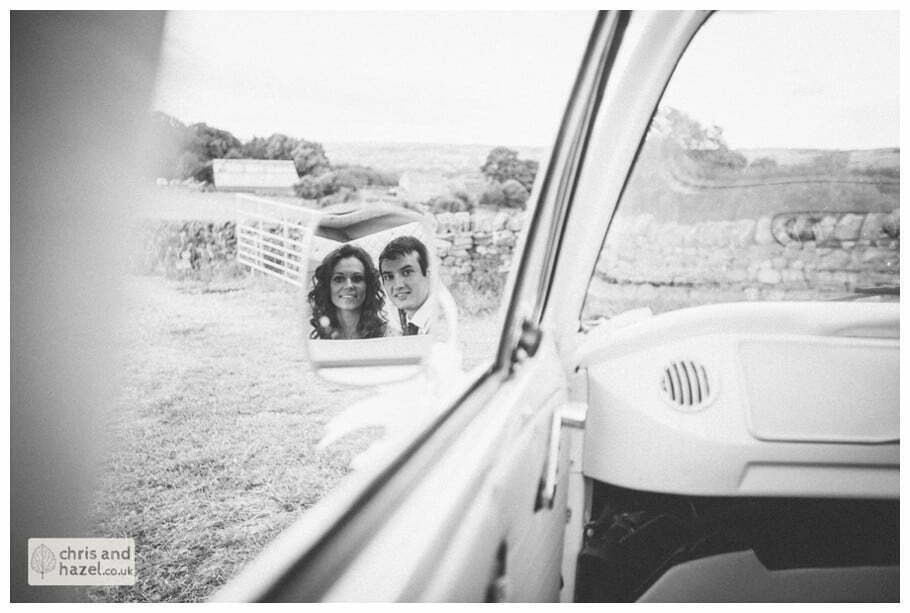 bride and groom with vw camper van wedding car mirror reflection rustic wedding theme hessian documentary Wedding Photographer Harrogate Wedding Photography Braisty Estate by Chris and Hazel Wedding Photography Jonny Dunn Stef Brown