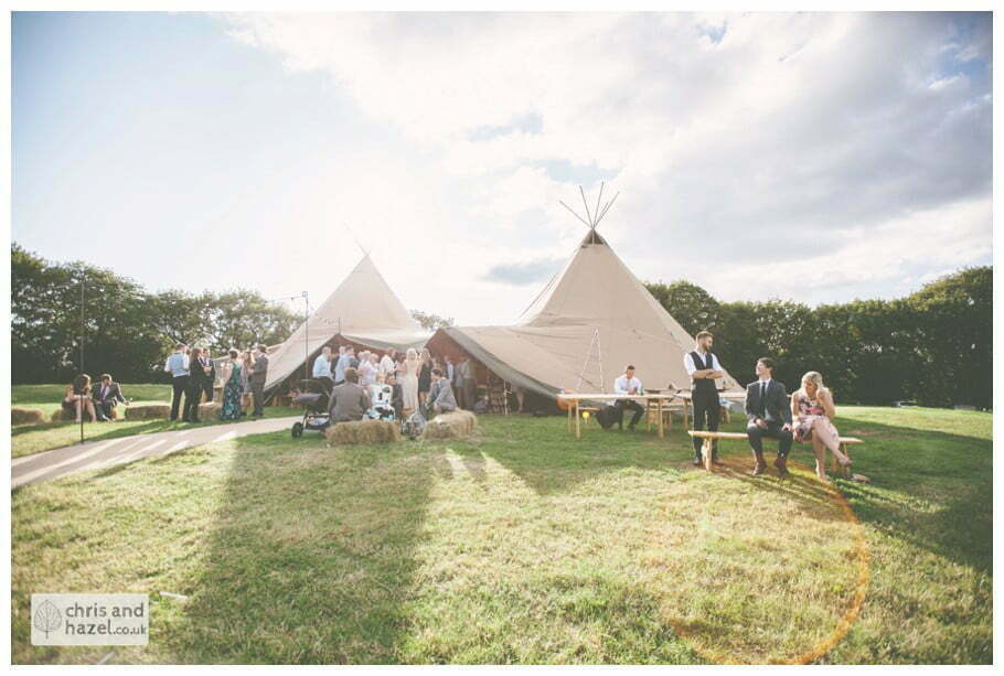 guests outside papkata tipi teepee rustic wedding theme hessian documentary Wedding Photographer Harrogate Wedding Photography Braisty Estate by Chris and Hazel Wedding Photography Jonny Dunn Stef Brown