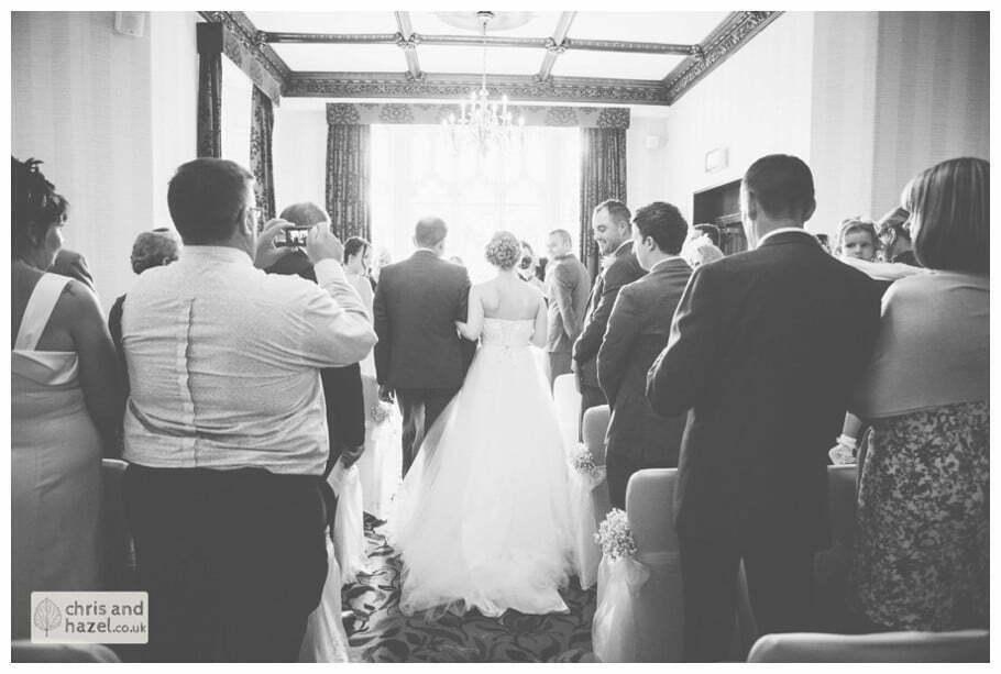 bride with father walking down aisle wedding ceremony kenwood hall documentary Sheffield Wedding Photographer Kenwood Hall Wedding Photography Sheffield by Chris and Hazel Wedding Photography Glen Briddock Emily Shaw