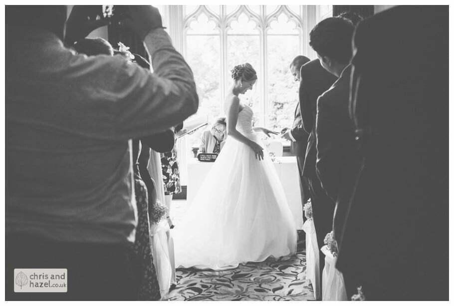 bride and groom ring exchange wedding ceremony kenwood hall documentary Sheffield Wedding Photographer Kenwood Hall Wedding Photography Sheffield by Chris and Hazel Wedding Photography Glen Briddock Emily Shaw