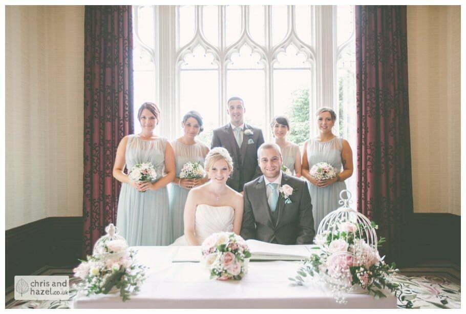 bride and groom sign register wedding ceremony kenwood hall documentary Sheffield Wedding Photographer Kenwood Hall Wedding Photography Sheffield by Chris and Hazel Wedding Photography Glen Briddock Emily Shaw
