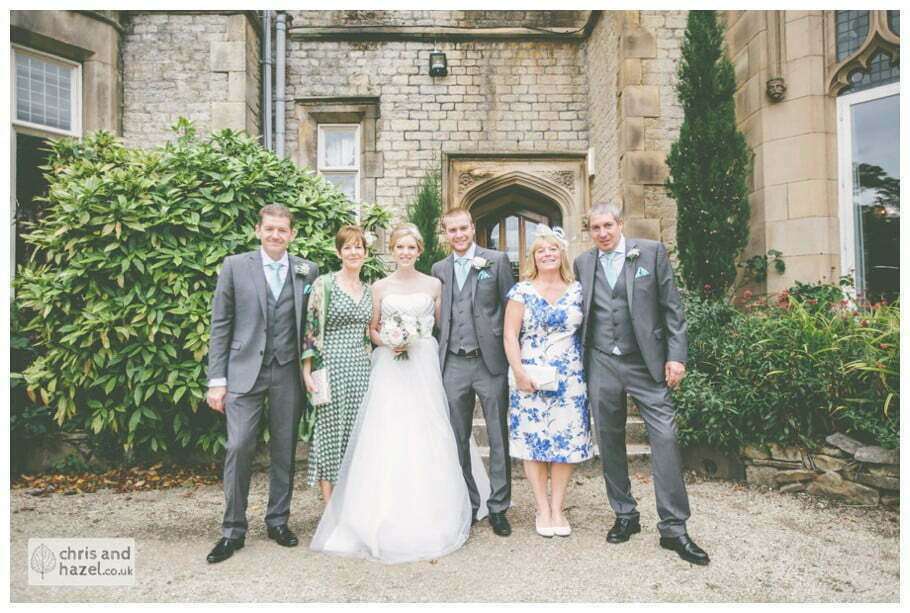 bride and groom with parents formal family photograph outside kenwood hall documentary Sheffield Wedding Photographer Kenwood Hall Wedding Photography Sheffield by Chris and Hazel Wedding Photography Glen Briddock Emily Shaw