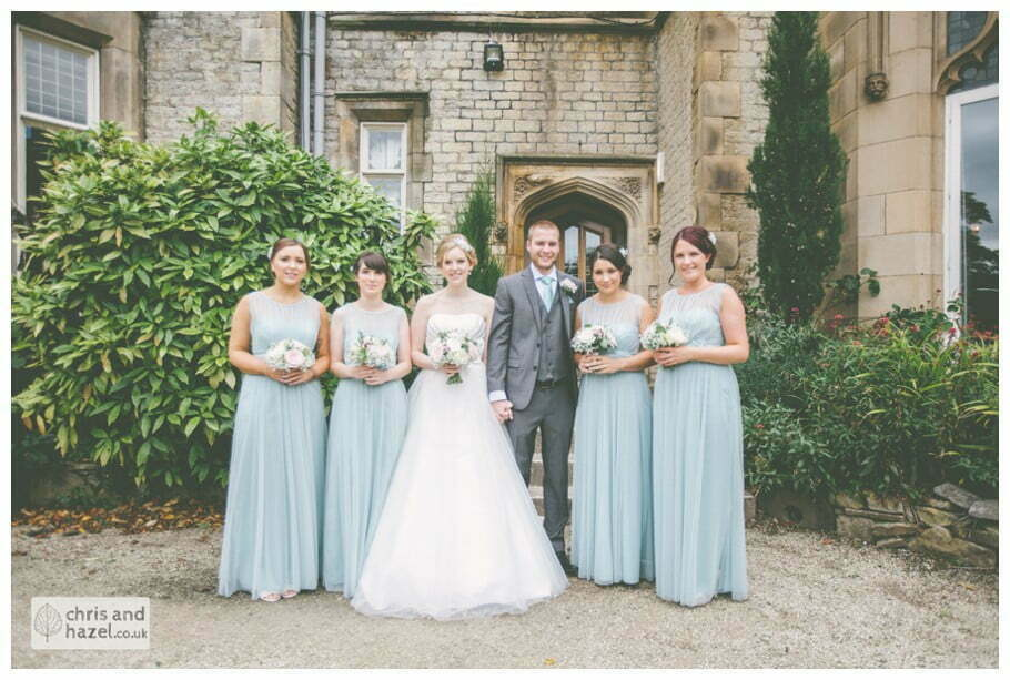 bride with bridesmaids formal family photograph outside kenwood hall documentary Sheffield Wedding Photographer Kenwood Hall Wedding Photography Sheffield by Chris and Hazel Wedding Photography Glen Briddock Emily Shaw