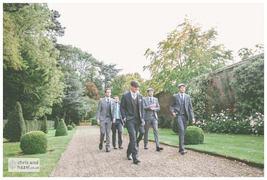 groom best man groomsmen ushers walking to venue documentary Hull Wedding Photographer Bishop Burton College Wedding Photography Hull by Chris and Hazel Wedding Photography Ross laurelin Matulis