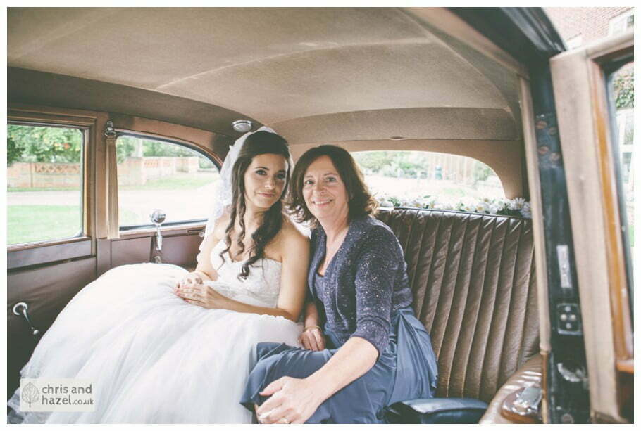 bride sat in wedding car with mother of bride documentary Hull Wedding Photographer Bishop Burton College Wedding Photography Hull by Chris and Hazel Wedding Photography Ross laurelin Matulis