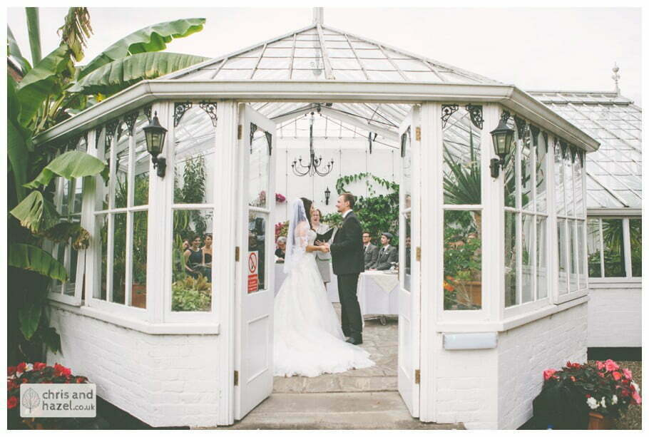 bride and groom vows wedding ceremony in greenhouse conservatory documentary Hull Wedding Photographer Bishop Burton College Wedding Photography Hull by Chris and Hazel Wedding Photography Ross laurelin Matulis