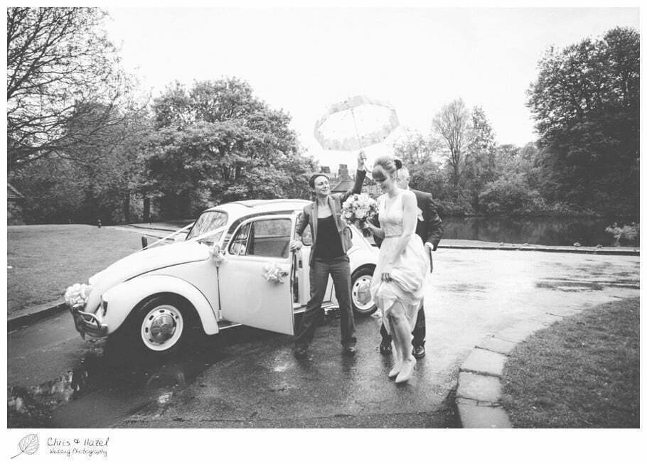 wet wedding, wedding umbrella, bride arriving, wedding car, vw beetle, volkswagen beetle wedding car, documentary wedding photography, Keighley ,Wedding Photographer, East Riddlesden Hall, Wedding Photography, Chris and Hazel Wedding Photography, Craig beasley, Stephanie Stubbs,