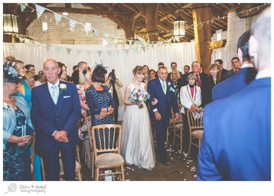 bride walking down aisle, bride entering wedding ceremony, barn, documentary wedding photography, Keighley ,Wedding Photographer, East Riddlesden Hall, Wedding Photography, Chris and Hazel Wedding Photography, Craig beasley, Stephanie Stubbs,