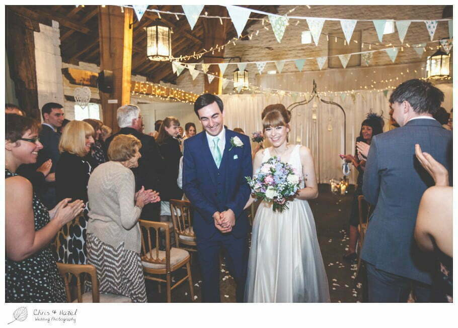 bride and groom, walking up aisle, wedding ceremony, barn, documentary wedding photography, Keighley ,Wedding Photographer, East Riddlesden Hall, Wedding Photography, Chris and Hazel Wedding Photography, Craig beasley, Stephanie Stubbs,