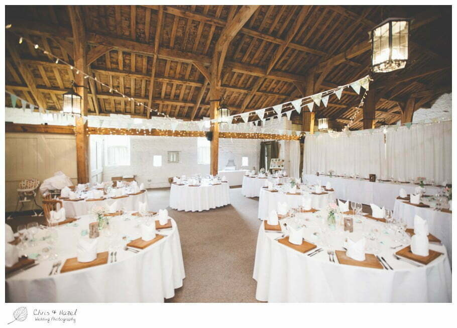tables laid for dinner, barn wedding breakfast, rustic, vintage, documentary wedding photography, Keighley ,Wedding Photographer, East Riddlesden Hall, Wedding Photography, Chris and Hazel Wedding Photography, Craig beasley, Stephanie Stubbs,