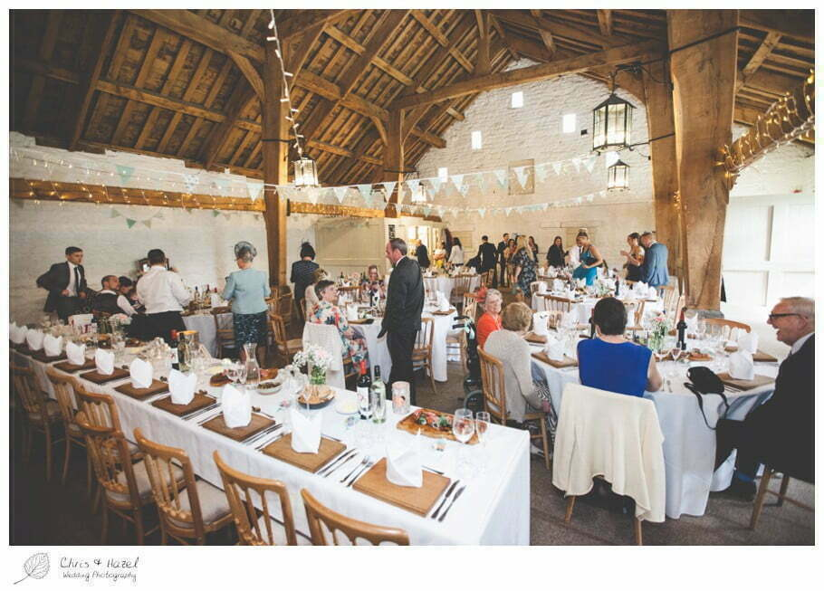 guests sitting down for wedding breakfast, barn wedding breakfast, rustic, vintage, documentary wedding photography, Keighley ,Wedding Photographer, East Riddlesden Hall, Wedding Photography, Chris and Hazel Wedding Photography, Craig beasley, Stephanie Stubbs,