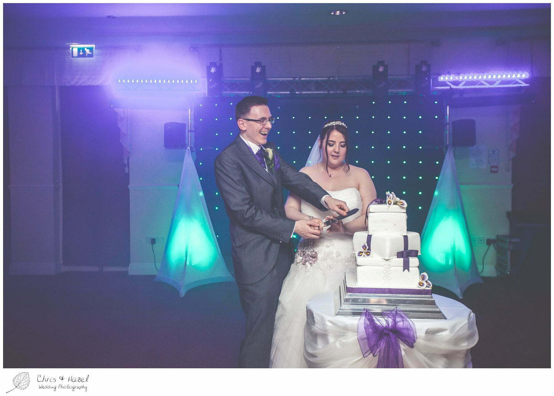 bride and groom cake cut cutting before first dance on dance floor, bagden hall wedding venue, documentary wedding photography, denny dale, huddersfield, Wedding Photographer, Bagden Hall, Wedding Photography, Chris and Hazel Wedding Photography, Alex tomenson, Vicky hunt