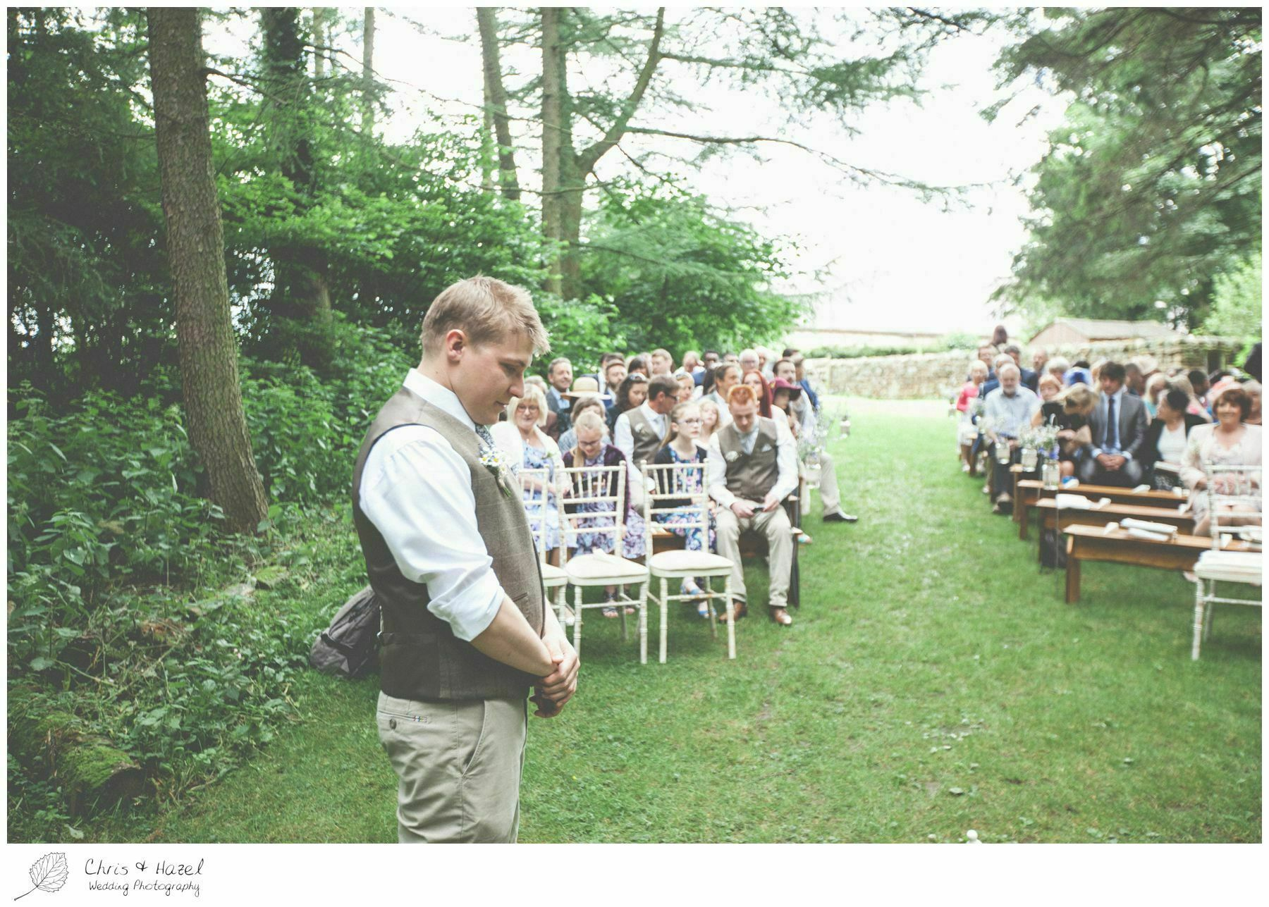 groom waiting for bride, woodland, forest, ceremony, outdoor, forest wedding, woodland wedding, eco wedding, love letters, wedding, Eccup Wedding Photographer, Lineham Farm, Wedding Photography Leeds, Chris and Hazel Wedding Photography, Richard Wyatt, Laura Kelly